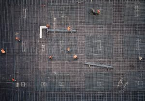 Aerial shot of construction workers on roof